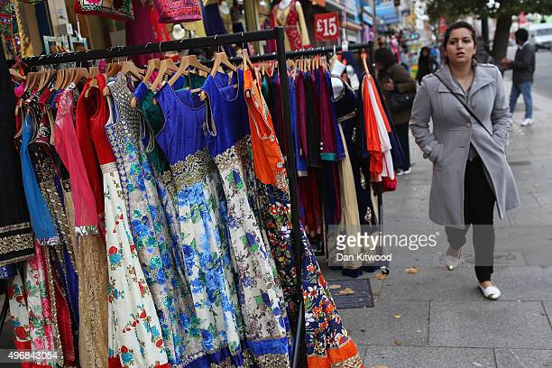 A woman walks past Saris outside a shop in Southall on November 12 2015 in London England In his first trip to Britain as Prime Minister Indian Prime...