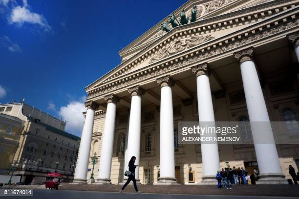 A woman walks past the Bolshoi Theatre in central Moscow on July 10 2017 Russia's Bolshoi theatre announced on July 9 the cancellation of next week's...