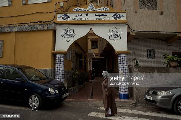 A woman walks past the entrance to one the mosques of El Principe district in Ceuta on December 3 2014 AFP PHOTO/ JORGE GUERRERO