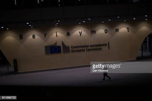 A woman walks past the European Union Commission headquarters on April 28 2017 in Brussels Belgium The 27 members of the European Union will meet in...