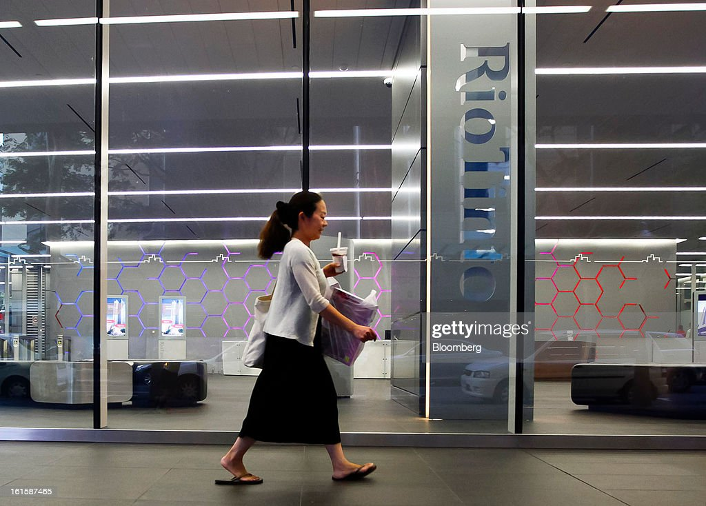 A woman walks past the foyer of Rio Tinto Group, in Brisbane, Australia, on Tuesday, Feb. 12, 2013. Rio Tinto, the world's second-biggest mining company, is scheduled to announce full-year earnings on Feb. 14. Photographer: Patrick Hamilton/Bloomberg via Getty Images