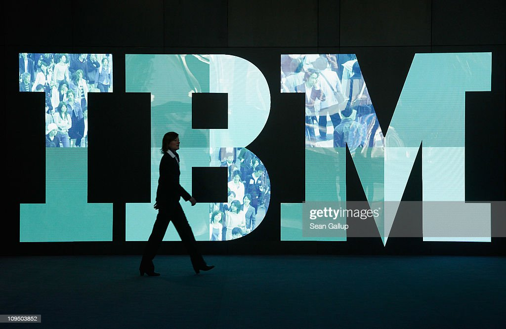 A woman walks past the IBM logo at the CeBIT technology trade fair the day before the fair's official opening on February 28, 2011 in Hanover, Germany. CeBIT 2011 will be open to the public from March 1-5.
