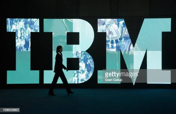 A woman walks past the IBM logo at the CeBIT technology trade fair the day before the fair's official opening on February 28 2011 in Hanover Germany...