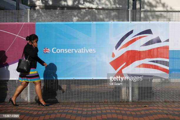 A woman walks past the International Convention Centre which is hosting the Conservative party conference on October 7 2012 in Birmingham England The...
