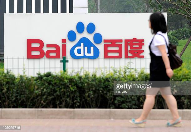 A woman walks past the logo of Baidu at its headquarter in Beijing on July 22 2010 Chinese Internet search giant Baidu said its profits more than...