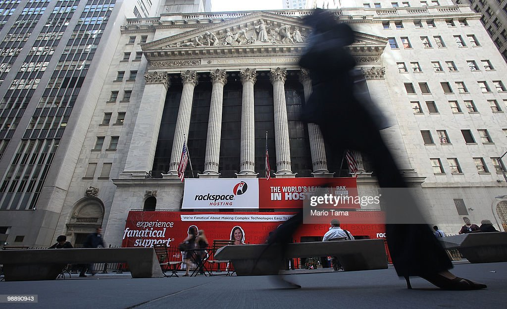A woman walks past the New York Stock Exchange before the closing bell May 6, 2010 in New York City. The Dow plunged almost 1000 points before closing down 347 on Greek debt fears.