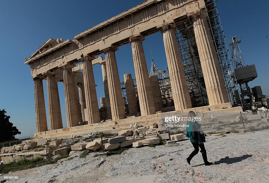 A woman walks past the Parthenon March 26, 2010 in Athens, Greece. Leaders of the sixteen euro zone countries along with the International Monetary Fund agreed March 26 to provide Greece with a 22 billion euro loan to help the country with its staggering debts, though it will only be available if open market lending to Greece dries up.