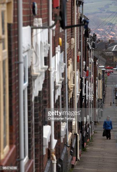 A woman walks past the terraced homes of Hanley on April 14 2010 in StokeonTrent Staffordshire Labour Party activists and local supporters in the...