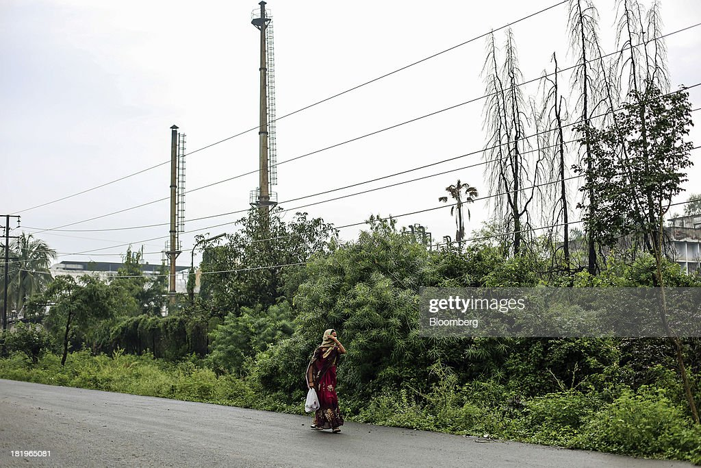 A woman walks past the Wockhardt Ltd. manufacturing facility in the Chikalthana industrial area in Aurangabad, India, on Monday, Sept. 16, 2013. Wockhardt currently controls about 26 percent of the U.S. market for metoprolol, a generic version of the heart pill sold by London-based AstraZeneca Plc under the brand name Toprol-XL, according to Needham & Co. Metoprolol alone makes up about 14 percent of the company's 56 billion rupees in annual revenue. Photographer: Dhiraj Singh/Bloomberg via Getty Images