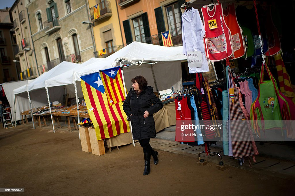 A woman walks past two pro-independent Catalonia flags on November 20, 2012 in Vic, Spain. Catalans will be voting in Parliamentary elections on November 25.