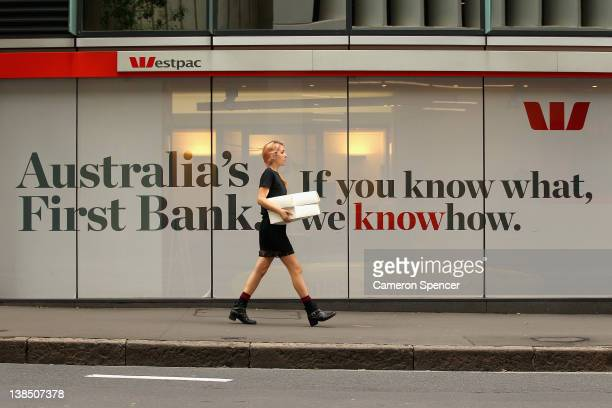 A woman walks past Westpac bank on February 8 2012 in Sydney Australia The Reserve Bank of Australia yesterday passed on a rate cut keeping the cash...