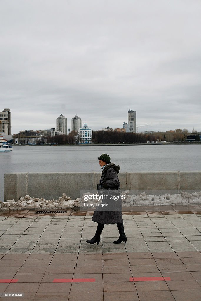 A woman walks past Yekaterinburg's central lake on November 3, 2011 in Yekaterinburg, Russia. Yekaterinburg is one of thirteen cities proposed as a host city for the 2018 FIFA World Cup in Russia.