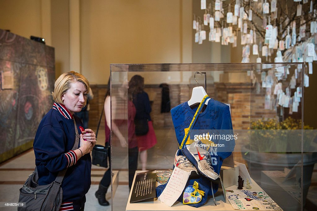 A woman walks through an exhibit titled, 'Dear Boston: Messages from the Marathon Memorial' in the Boston Public Library to commemorate the 2013 Boston Maraton bombings, on April 14, 2014 in Boston, Massachusetts. Last year, two pressure cooker bombs killed three and injured an estimated 264 others during the Boston marathon, on April 15, 2013.