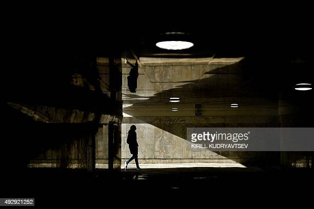 A woman walks through an underground crossing in Moscow on October 16 2015 AFP PHOTO / KIRILL KUDRYAVTSEV