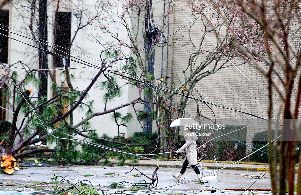 A woman walks through downed power lines along Hardy Street near the University of Southern Mississippi after a tornado touched down yesterday evening on February 11, 2013 in Hattiesburg, Mississippi. Hundreds of homes were destroyed and over sixty people injured when the tornado ripped through the town.
