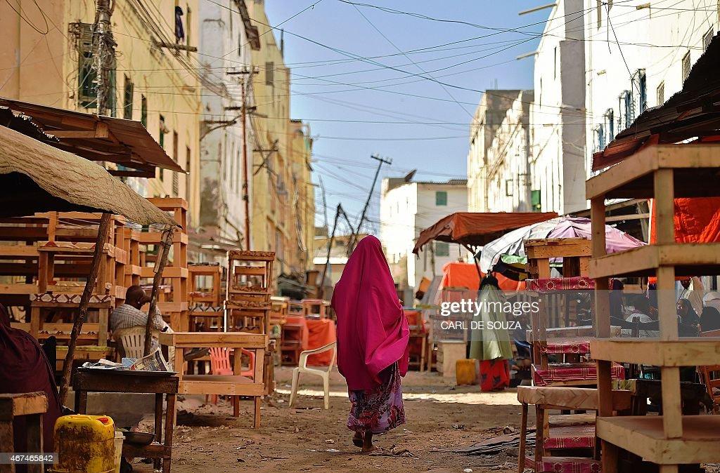 A woman walks through Hamarweyne district in South Mogadishu on March 25 2015 AFP PHOTO/Carl de Souza