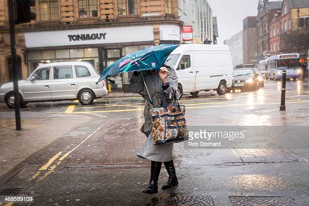A woman walks through heavy rain and hail in Worcester city centre on February 11 2014 in Worcester England The Environment Agency has issued flood...