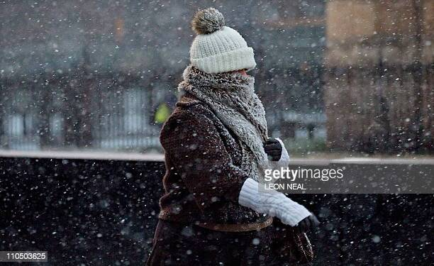 A woman walks through heavy snowfall in central London on January 6 2010 Millions of people in London and the southeast of England were blanketed in...