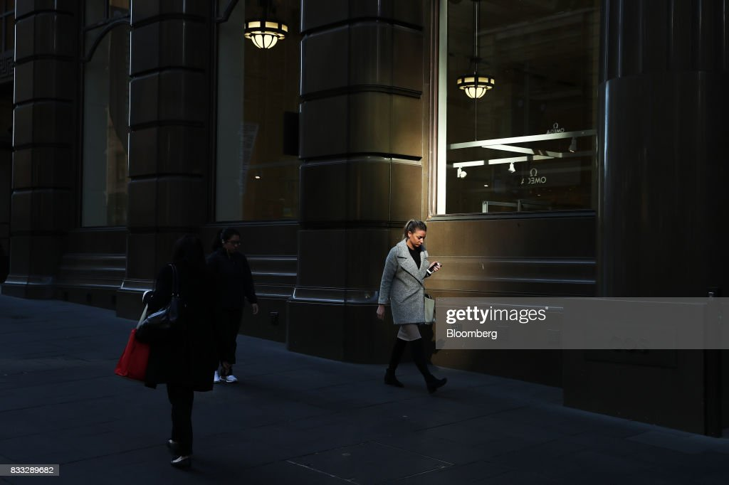 A woman walks through Martin Place in Sydney, Australia, on Thursday, Aug. 17, 2017. Australian employers added more jobs than forecast in July, underscoring the central banks confidence in an improving labor market. Photographer: Brendon Thorne/Bloomberg via Getty Images