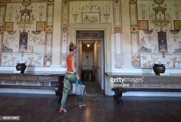 A woman walks through one of the rooms called Cagliostra in the Castel Sant'Angelo in Rome on July 16 2015 The rooms Cagliostro take their name from...