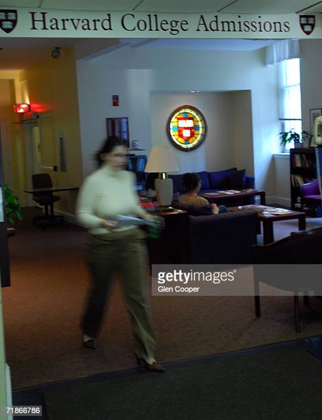 A woman walks through the Admissions Building at Harvard University September 12 2006 in Cambridge Massachusetts Harvard is eliminating early...