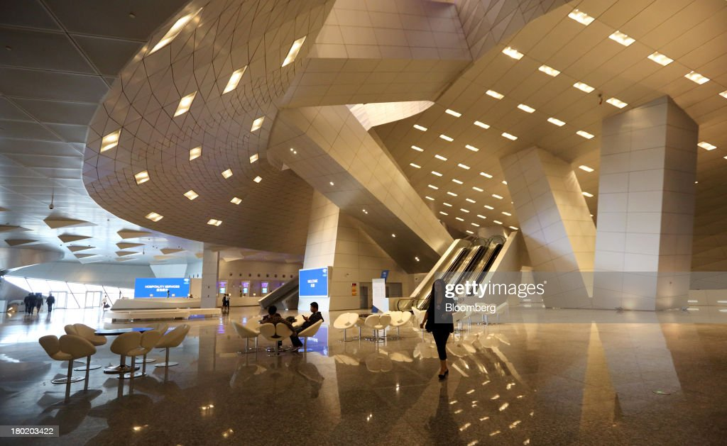 A woman walks through the Dalian International Conference Center in Dalian, China, on Tuesday, Sept. 10, 2013. The World Economic Forum Annual Meeting Of The New Champions 2013 will be held in Dalian from Sept. 11 to 13. Photographer: Tomohiro Ohsumi/Bloomberg via Getty Images