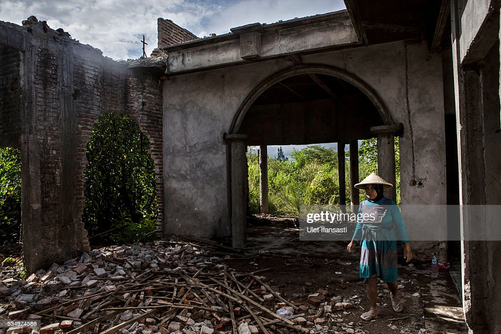 A woman walks through the demolition on May 27, 2016 in Sidoarjo, East Java, Indonesia. Residents of villages that were damaged by the Sidoarjo mudflow and residents received compensation, after almost ten years, from the Indonesian oil and gas company, PT Lapindo Brantas. The mudflow eruption is suspected to have been triggered by the drilling activities of oil and gas company, though they refute the claims, instead blaming a 6.3 magnitude earthquake that struck a neighboring city two days before the mudflow eruption. The earthquake struck Yogyakarta on May 27th, 2006, a city 150 miles west of a drill site in Sidoarjo, two days before the mudflow eruption. According to reports, twenty lives were lost and nearly 40,000 people displaced, with damages topping $2.7 billion. Ten years since the eruption, the mud geysers continue to spurt daily and high levels of heavy metals have been detected in nearby rivers.