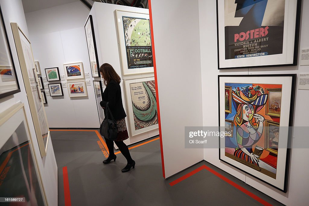 A woman walks through the exhibition 'Poster Art 150 - London Underground's Greatest Designs' in the London Transport Museum on February 12, 2013 in London, England. The exhibition celebrates 150 years of the London Underground by showcasing 150 posters from the Museum's archive of over 3,300. The exhibition opens on February 15, 2013 and runs until October 27, 2013.