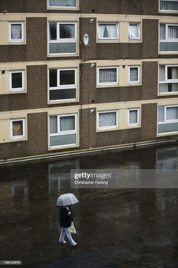 A woman walks through the Falinge Estate, which has been surveyed as the most deprived area in England for a fifth year in a row, on January 8, 2013 in Rochdale, England. According to data provided by the Department for Communities and Local Government, 72 per cent of people in the local area are unemployed and seven per cent have never had a job. Four out of five children on the estate are living in poverty, with the area having one of the highest teenage pregnancy rates in the country. During today's House of Commons debate, the government urged MPs to back their planned 1 per cent cap on annual rises in benefits and some tax credits for three years from next April. Benefits for people of working age have historically risen in line with the rate of inflation.