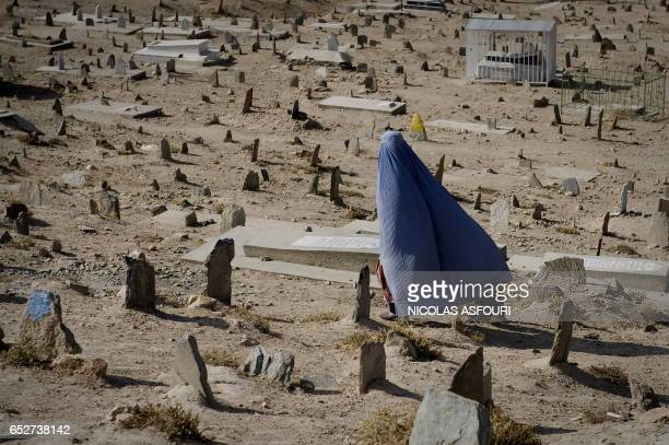 A woman walks through the KartE Sakhi cemetery in Kabul on November 3 2009 Afghan President Hamid Karzai vowed that his new government would...