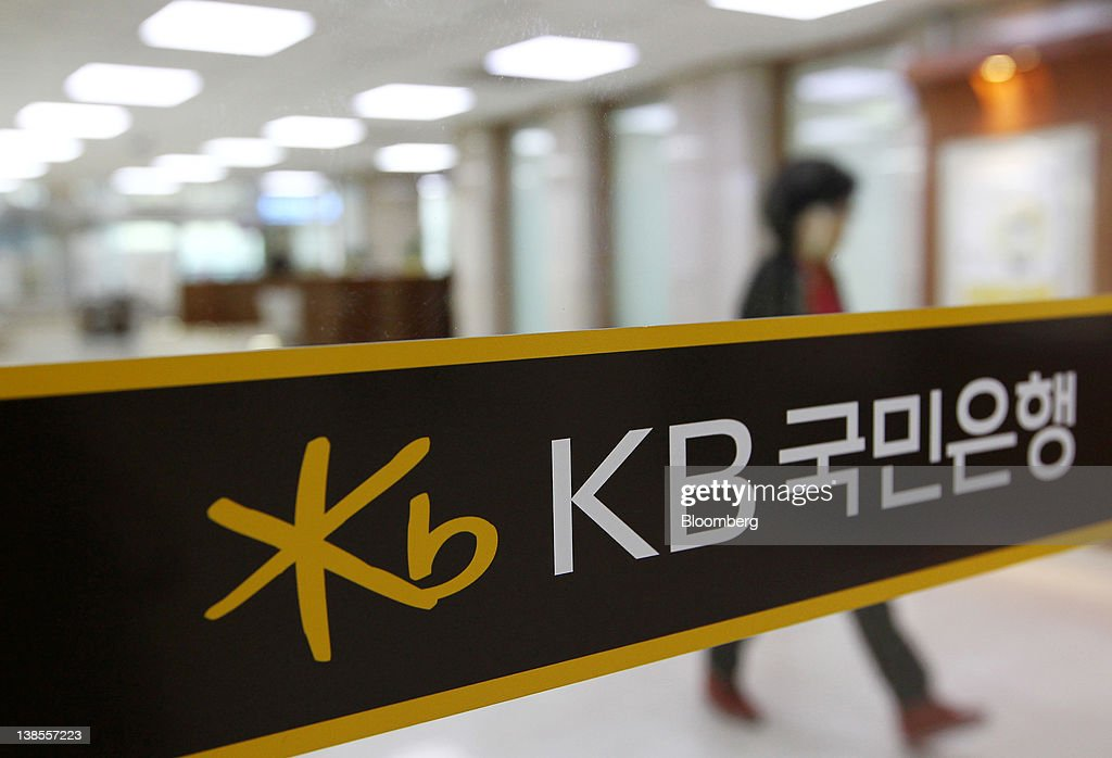 A woman walks through the Kookmin Bank headquarters in Seoul, South Korea, on Thursday, Feb. 9, 2012. KB Financial Group Inc., owner of South Korea's largest lender, posted its lowest quarterly profit in a year on increased provisions for bad debts. Photographer: SeongJoon Cho/Bloomberg via Getty Images
