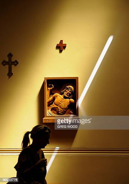 A woman walks through the Mary MacKillop Memorial Chapel in Sydney on February 20 2010 Pope Benedict XVI has announced MacKillop will become...