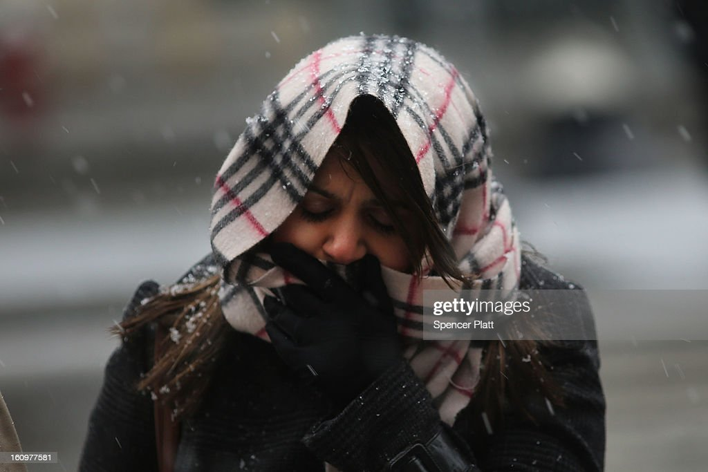A woman walks through wind, snow and sleet on Broadway as Manhattan prepares for a major winter storm on February 8, 2013 in New York City. New York City and much of the Northeast is expected to get a foot or more of snow through Saturday afternoon with possible record-setting blizzard conditions expected. Heavy snow warnings are in effect from New Jersey through southern Maine.
