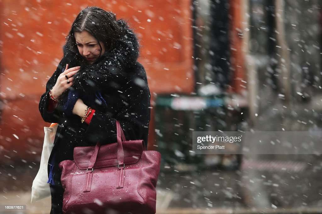 A woman walks through wind, snow and sleet on Broadway during the beginning of a major winter storm on February 8, 2013 in New York City. New York City and much of the Northeast is expected to get a foot or more of snow through Saturday afternoon with possible record-setting blizzard conditions expected. Heavy snow warnings are in effect from New Jersey through southern Maine.
