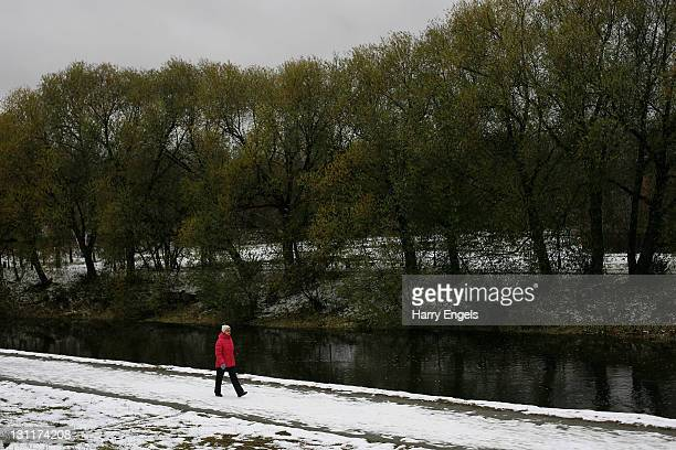 A woman walks through Yekaterinburg's central park on November 2 2011 in Yekaterinburg Russia Yekaterinburg is one of thirteen cities proposed as a...