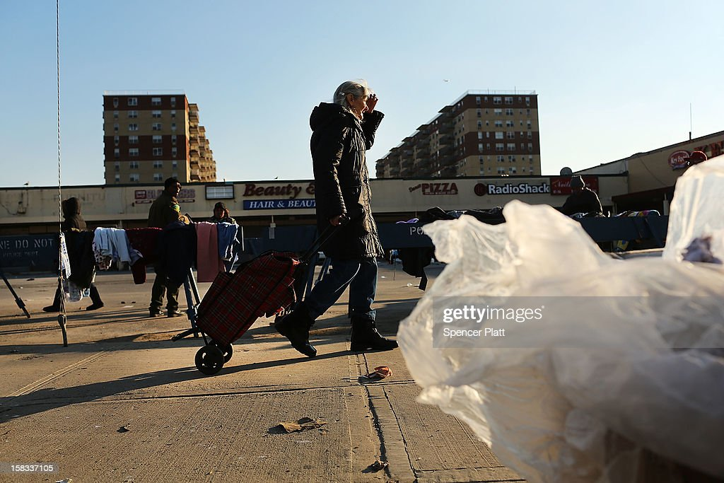 A woman walks to a free clothing distribution site near the beach in Rockaway on December 13, 2012 in New York City. Much of the Rockaway neighborhood is still suffering the effects of Hurricane Sandy which caused extensive damage to parts of New York, New Jersey and Connecticut. Thousands of Rockaway residents and business owners are still unable to return to their properties while electricity remains sporadic in many neighborhoods.