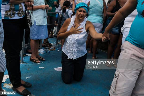 A woman walks under her knees to pay a promise to the Immaculate Conception during the Catholic festivities in the city of Recife Northeast Brazil on...