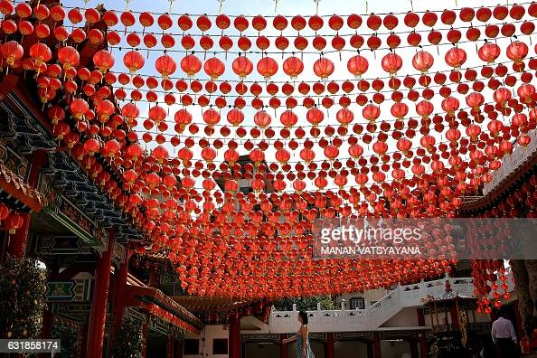 TOPSHOT A woman walks under traditional Chinese lanterns decorated at the Thean Hou temple ahead of Lunar New Year of the rooster celebrations in...