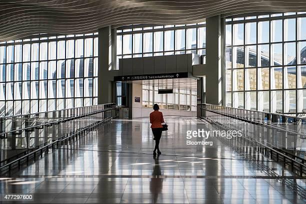 A woman walks up a ramp at Terminal 2 of Hong Kong International Airport in Hong Kong China on Monday June 15 2015 The Hong Kong government in March...