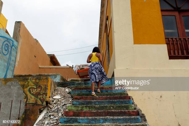 A woman walks up the stairs in the neighbourhood of La Perla where the video 'Despacito' was recorded in San Juan on July 22 2017 Something unusual...