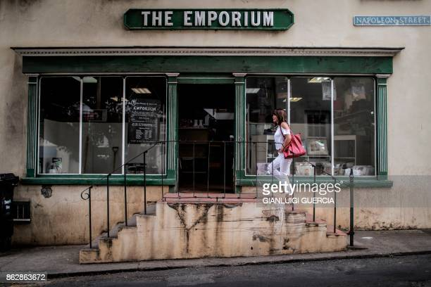 A woman walks up the stairs of a wholesale shop on Napoleon Street in Jamestown on October 18 2017 in the British Overseas Territory of Saint Helena...