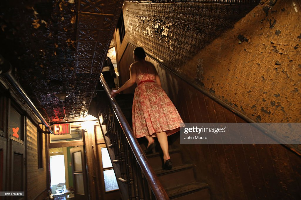 A woman walks up the stairs through the Lower East Side Tenement Museum on April 9, 2013 in New York City. The landmark museum preserves the history of more than 7,000 immigrants from more than 20 nations that lived, often in very cramped conditions, in the building between 1863 and 1935.