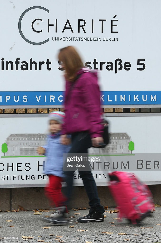A woman walks with a child past a sign marking an entrance to the Virchow campus of Charite hospital two days after Charite officials announced an early-born infant died of an infection at Charite Virchow on October 22, 2012 in Berlin, Germany. Hospital officials announced the infant died two weeks ago of a bacterial infection and that seven other infants are ill but in stabile condition. Health authorities are investigating. Germany has seen a string of infant deaths in the last year nationwide due to poor hygiene at several hospitals and clinics.