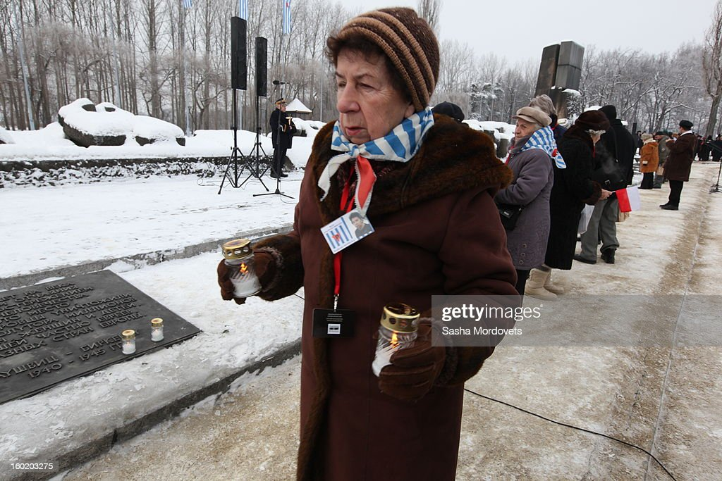 A woman walks with candles at the former Auschwitz Birkenau Nazi concentration camp January 27, 2013 near Oswiecim, Poland. A ceremony marked the 68th anniversary of the liberation of the camp during International Holocaust Remembrance Day.