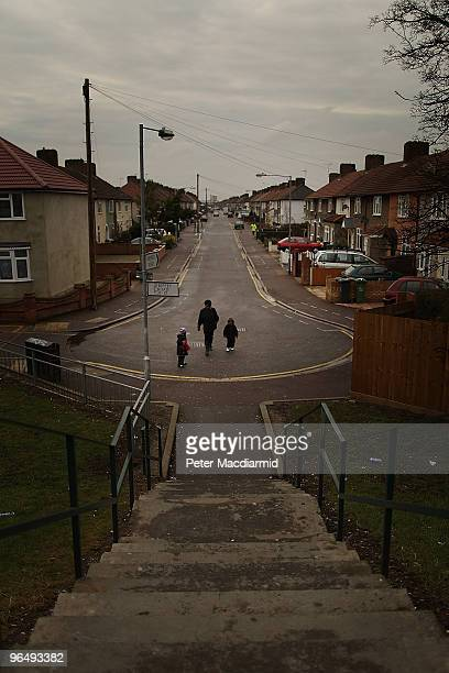 A woman walks with her children in a residential street on February 4 2010 in Becontree England As the UK gears up for one of the most hotly...