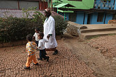 A woman walks with orphans at the AGOHELD orphanage hospital training center and school founded by Abebech Gobena on March 19 2013 in Addis Ababa...