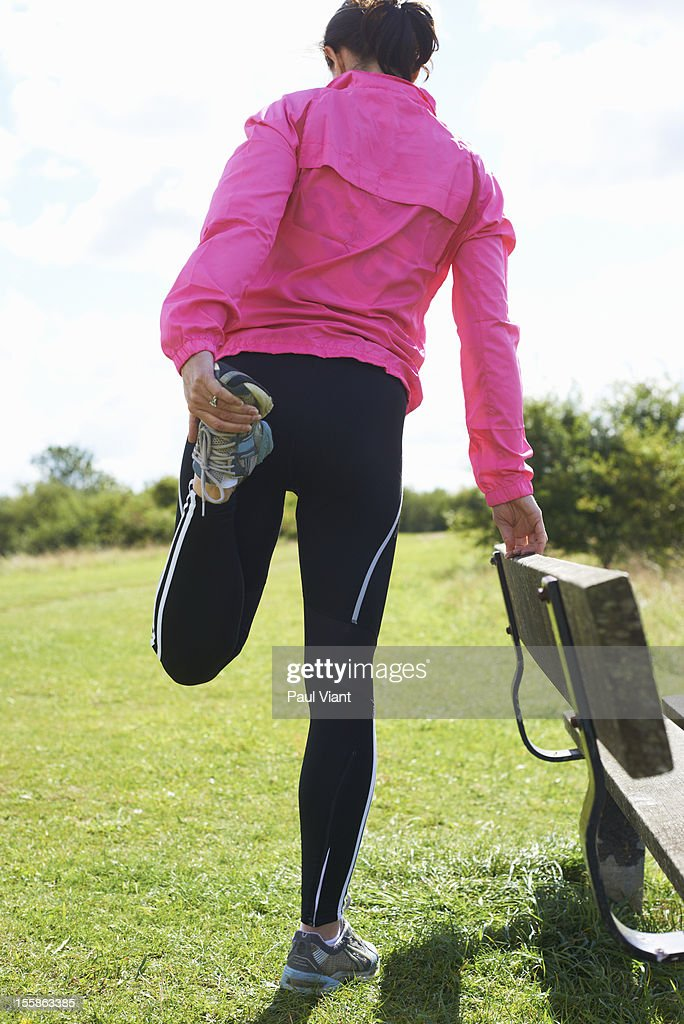 Woman warming up before running : Stock Photo