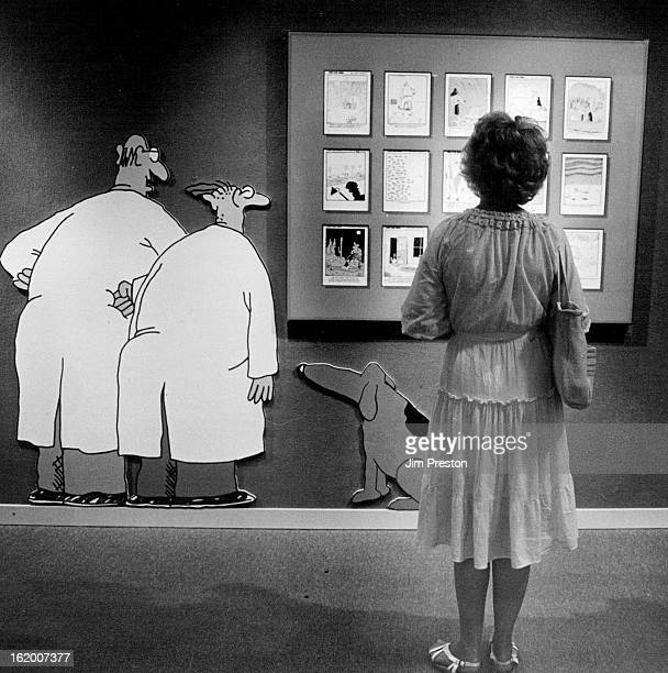JUL 11 1986 JUL 12 1986 A woman was able to get away from the crowds for a moment and view some of Gary Larson's Far Side cartoons at the Museum of...