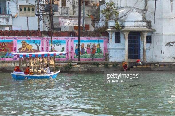 Woman washes clothes near a boat in Lake Pichola | Udaipur | Rajasthan