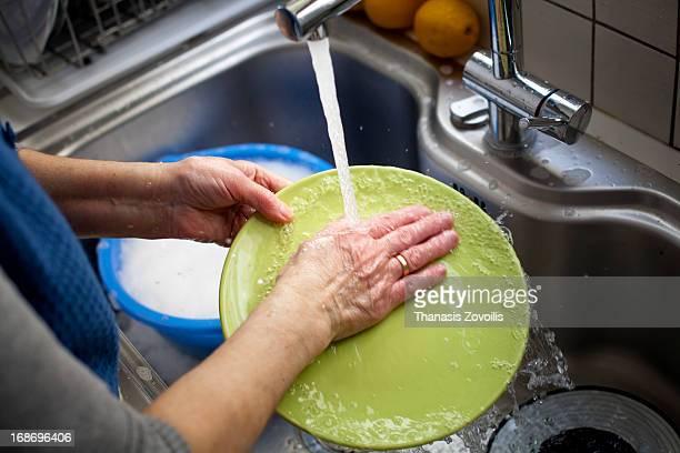Woman washing a plate